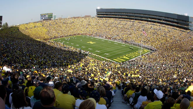 A 2010 file photo of a packed Michigan Stadium in Ann Arbor.