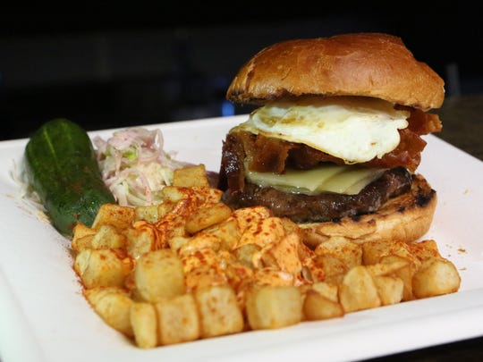 """The breakfast burger at the Yonkers Brewing Co. during their first """"blackout brunch"""" at the brewery, March 26, 2016. There were drink specials, a DJ, and lots of food."""