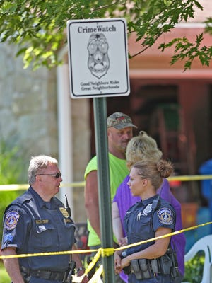 Police stand at the crime tape as neighbors wait to hear more about Investigation at the scene in the 1800 block of Forsythia Dr. where three bodies have been found, Thursday, June 1, 2017.
