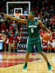 Dec 5, 2017; Piscataway, NJ, USA; Michigan State Spartans guard Cassius Winston (5) sets up a play during first half against Rutgers Scarlet Knights  at Louis Brown Athletic Center.