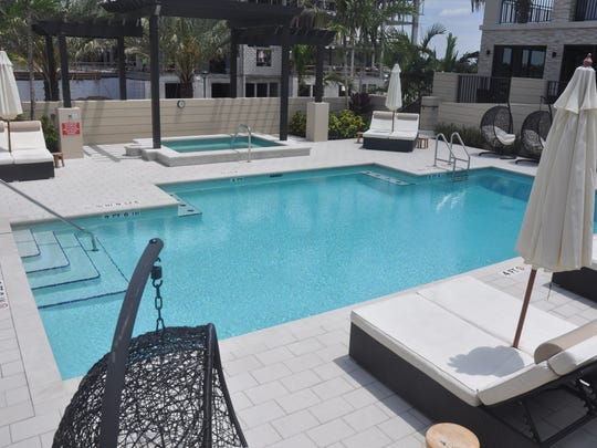 Each building has a large interior courtyard with a pool, tiki huts, fire pits, and gardens. Each building also has a social room. Then there will be two fitness rooms for the four buildings to share.
