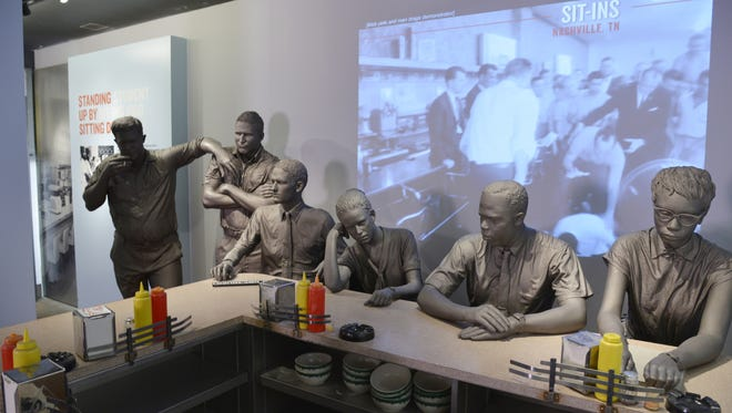 """The National Civil Rights Museum's """"Standing Up by Sitting Down"""" exhibit highlights non-violent protests."""