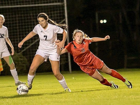 Stewarts Creek's Kaitlyn Watson starts to fall as she