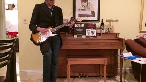 Sawyer on guitar, courtesy of YouTube.