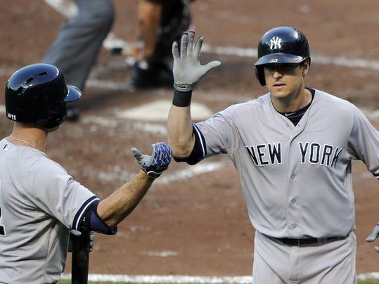 MORBrd_07-12-2014_Daily_1_B004~~2014~07~11~IMG_Yankees_Orioles_Base_2_1_H97U.jpg