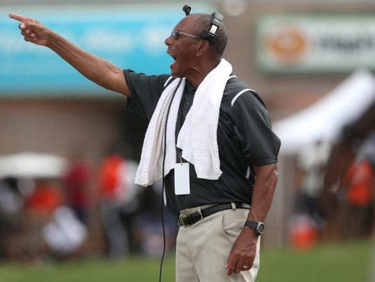 FAMU Head Coach Alex Wood yells out to his team during