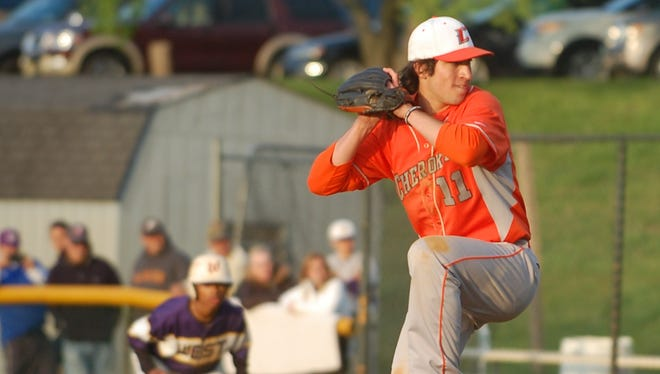 Nick Schooley delivers a pitch in the 12th inning of Wednesday's Olympic American victory over Cherry Hill West.