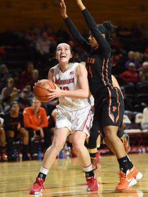 Marist College's Maura Fitzpatrick sets to shoot while she is guarded by a Princeton defender at McCann Arena on Dec. 29, 2015.