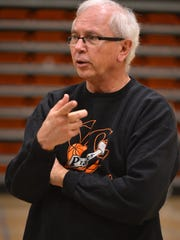 Ned Mircetic, head coach for the Ventura College women's basketball team, instructs his players during a practice.