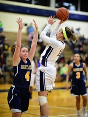 Hartland's Emily Messner (4) tries to thwart a jumper