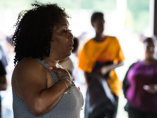 Salisbury City Councilwoman April Jackson speaks to a crowd during the Stop the Violence candle and prayer vigil at Billy Gene Jackson Senior Park on Monday, July 10, 2017.