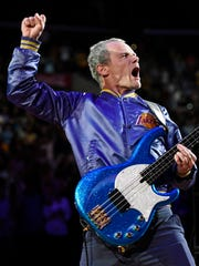 FILE - In this April 13, 2014 file photo, Flea, bassist for the Red Hot Chili Peppers, plays the national anthem prior to an NBA basketball game between the Los Angeles Lakers and the Memphis Grizzlies in Los Angeles.