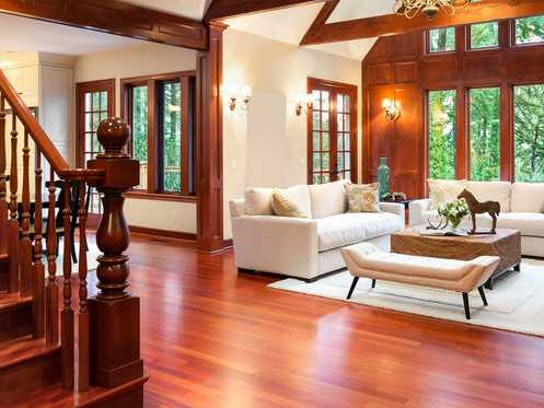 A large, bright entryway with nice hardwood flooring.