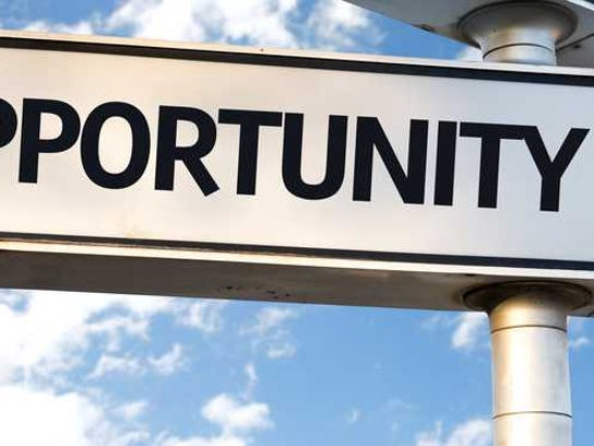 A sign with an arrow says opportunity.