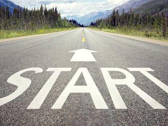 A street has the word start written on it with an arrow