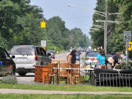Vehicles are stopped for the Yard Sale Trail