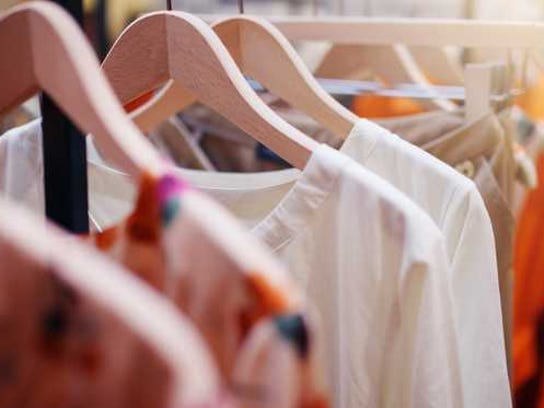 Retail clothing hanging on a rack.