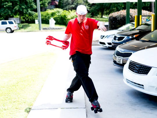 Carhop James Moffet skates around the parking lot at Sonic at 3307 N. Broadway in Knoxville, Tennessee, on Thursday, July 19, 2018. Moffet, 29, is one of five skating carhops to participate in the national Sonic Skate-Off competition next month.