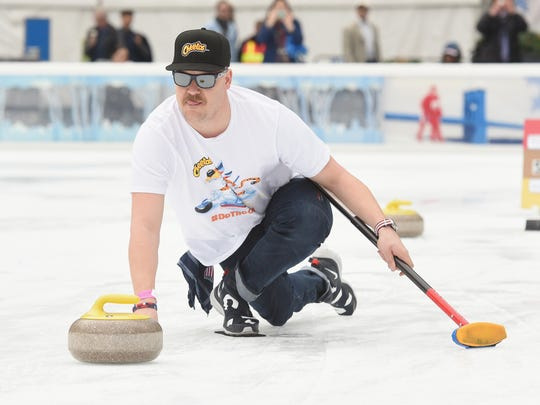 Matt Hamilton of the U.S. men's curling team joined Cheetos recently to demonstrate to fans how to curl at an event at the Bank of America Winter Village in New York.