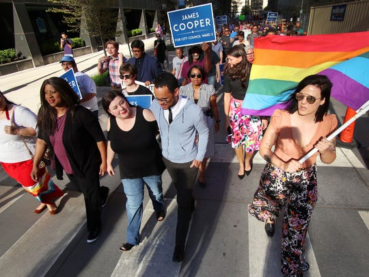 Kelley Blair, CEO and founder of Diversity Center of Oklahoma, walks arm-in-arm with James Cooper and Allie Shinn, right, executive director of Freedom Oklahoma, as marchers join Councilman-elect James Cooper in a march to City Hall in support of the LGBTQ community in Oklahoma City on April 8, 2019.