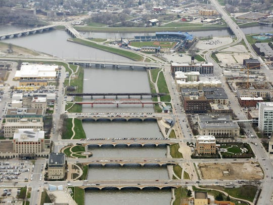 An aerial view of the Des Moines River as it passes by downtown and meets the Raccoon River March 30, 2016, in Des Moines.