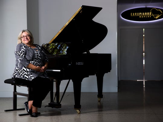 Europianos of Naples gallery owner Sunny Reuter sits with the one her last piano's in the store, made by designer Paolo Fazioli, in her brick and mortar store along north U.S. 41 Wednesday, June 28, 2017 in Naples. Reuter's business is changing with the times and switching to an entirely online approach.