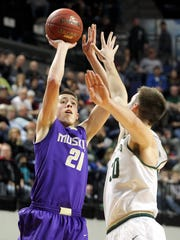 Muscatine's Joe Wieskamp shoots over West High's Connor McCaffery during their game at the U.S. Cellular Center in Cedar Rapids on Tuesday. Both are committed to play at Iowa in college.