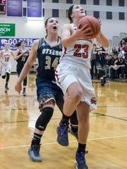 Marshall's Nikki Tucker (23) goes for the hoop during