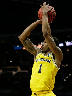Michigan's Charles Matthews shoots a 3-pointer against Texas A&M during the first half of Sweet 16 of the NCAA tournament in Los Angeles on Thursday, March 22, 2018.