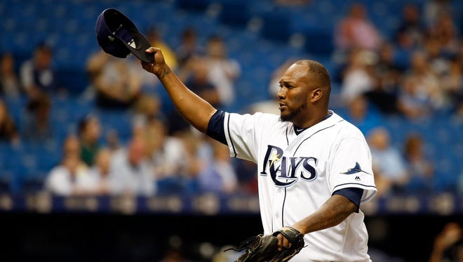 Tampa Bay Rays relief pitcher Jumbo Diaz tips his hat to the crowd at the end of the sixth inning against the New York Yankees the at Tropicana Field in St. Petersburg, Fla.
