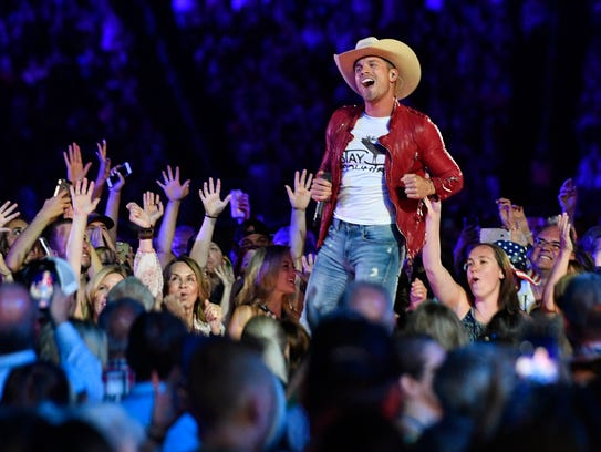 Dustin Lynch performs in the crowd during the CMA Fest