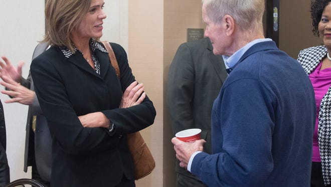 Judge Casey Rodgers, left, gives Senator Bill Nelson, right, an update on the federal courthouse during the his stop in Pensacola Monday morning.