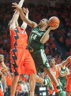 Michigan State freshman center Nick Ward picks up an offensive foul as he tries to score late against Illinois' Maverick Morgan. Ward finished with 11 points and six rebounds in 21 minutes, but watched the end of the game from the bench.