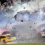 Austin Dillon's No. 3 car goes airborne and hits the catch fence during a multi-car crash on the final lap of the Sprint Cup Series race at Daytona International Speedway.