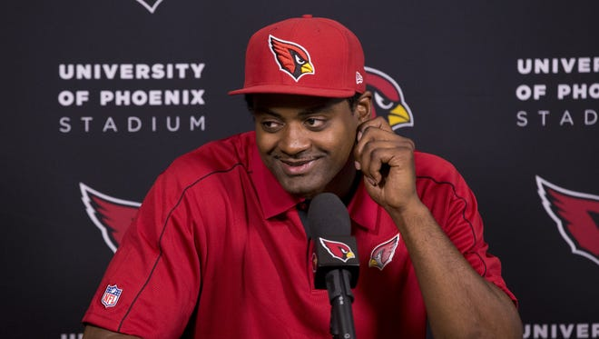 Linebacker Karlos Dansby signs a 1-year deal with the Arizona Cardinals on March 10, 2017 at the Cardinals training facility in Tempe.