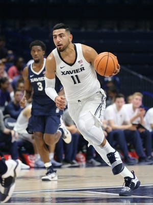 Xavier Musketeers forward Kerem Kanter (11) brings the ball up the court during Musketeer Madness, Friday, Oct. 20, 2017, at Cintas Center in Cincinnati.