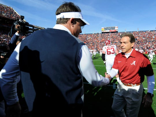 Auburn head coach Gus Malzahn and Alabama head coach Nick Saban begin the season with high expectations. The Tigers and Crimson Tide are both ranked in the top five in the Amway Coaches Poll.  USA TODAY SPORTS Nov 30, 2013; Auburn, AL, USA; Auburn Tigers head coach Gus Malzahn (left) shakes hands with Alabama Crimson Tide head coach Nick Saban (right) prior to the game at Jordan Hare Stadium. Mandatory Credit: RVR Photos-USA TODAY Sports