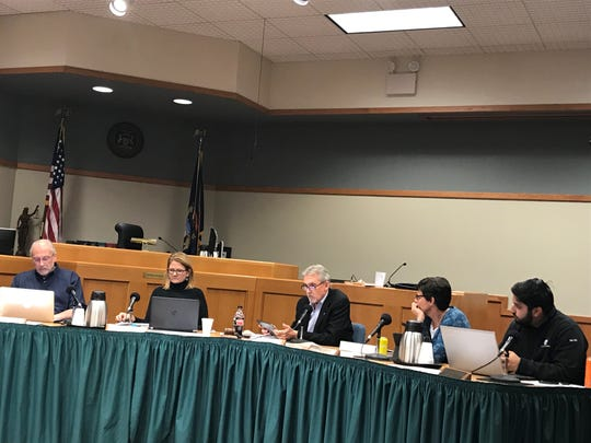 From left, East Lansing City Council members Erik Altmann, Shanna Draheim, Mark Meadows, Ruth Beier and Aaron Stephens haggle over a medical marijuana dispensary ordinance during a meeting on October, 31, 2018. The ordinance failed, with Altmann, Draheim and Stephens voting against.
