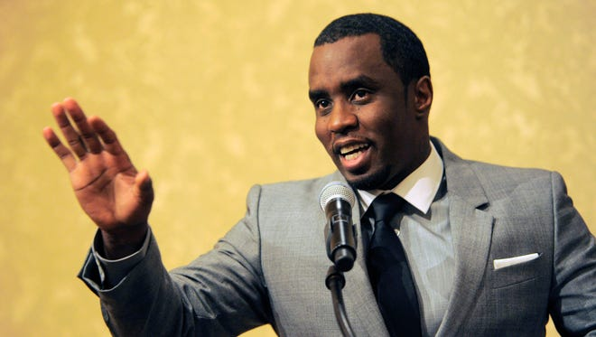"""FILE - In this July 26, 2013 file photo, Sean """"Diddy"""" Combs of the new network Revolt TV addresses reporters at the Beverly Hilton Hotel in Beverly Hills, Calif. Police say hip-hop music mogul Combs has been arrested on the campus of the University of California, Los Angeles. UCLA police spokeswoman Nancy Greenstein confirmed that Combs was taken into custody by campus officers on Monday, June 22, 2015. Greenstein did not immediately provide further details. (Photo by Chris Pizzello/Invision/AP, File)"""