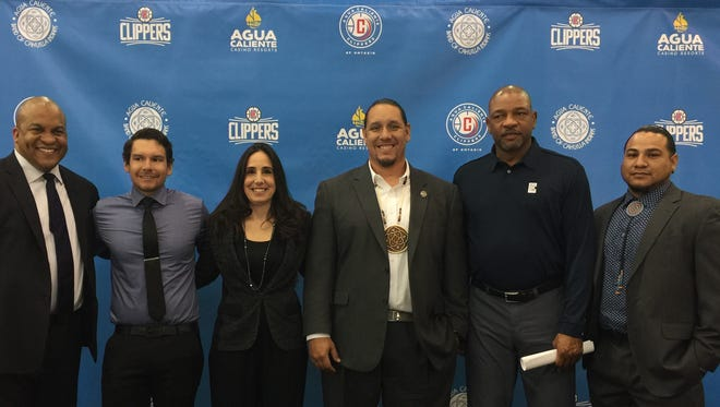 Agua Caliente Tribal Chairman Jeff Grubbe, center, and Clippers head coach Doc Rivers, right of Grubbe, with officials from the Agua Caliente Band of Cahuilla Indians and the Clippers organization.