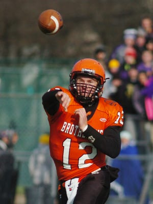 Alex Malzone started 26 games at quarterback for Brother Rice, finishing with a 25-1 record. He led the Warriors to a perfect 14-0 record in winning the Division 2 state championship as a junior.