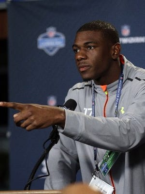 Former Michigan wide receiver Devin Funchess answers a question during a news conference at the NFL combine in Indianapolis on Feb. 19, 2015.