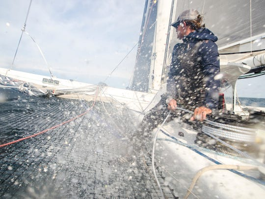Arete crew member Don Massey gets sprayed by water