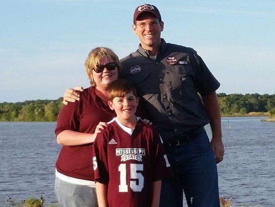 Deputy William Durr (right) with wife Tressie and son