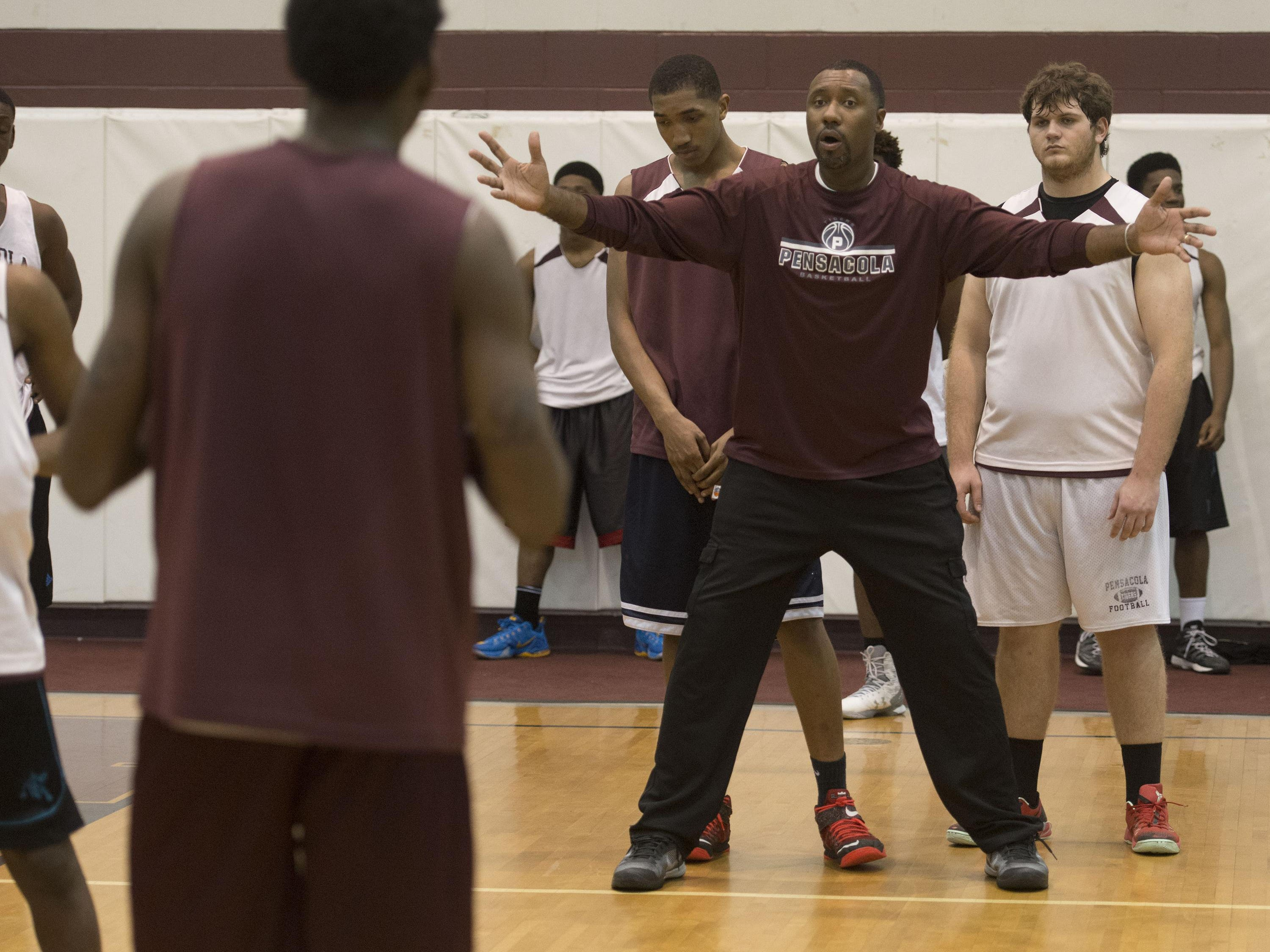 Pensacola High School Basketball coach, Terrence Harris, works to get his team ready for the Region 6A Semifinals game in Lakeland.