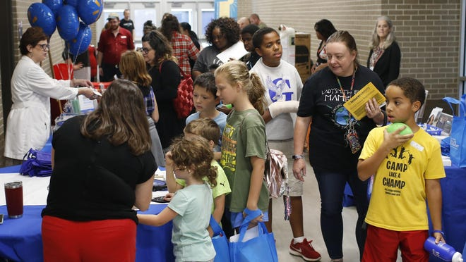 In this 2019 file photo, students and parents attend Community Health Night at Hilsman Middle School in Athens, Ga., on Tuesday, Oct. 8, 2019.