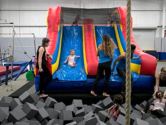 Katelin Tomlinson, 4, slides down the new inflatable