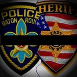 Two Baton Rouge police officers and an East Baton Rouge sheriff's deputy were killed in some kind of shootout in Baton Rouge Sunday morning.