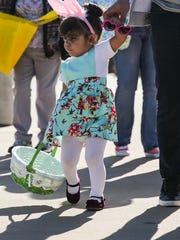 Aria Zapata, 2, arrives with her family to Easter Fest Saturday, March 31, 2018, at Texas Bank Sports Complex.