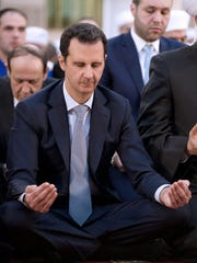 Syrian President Bashar Assad performs the morning